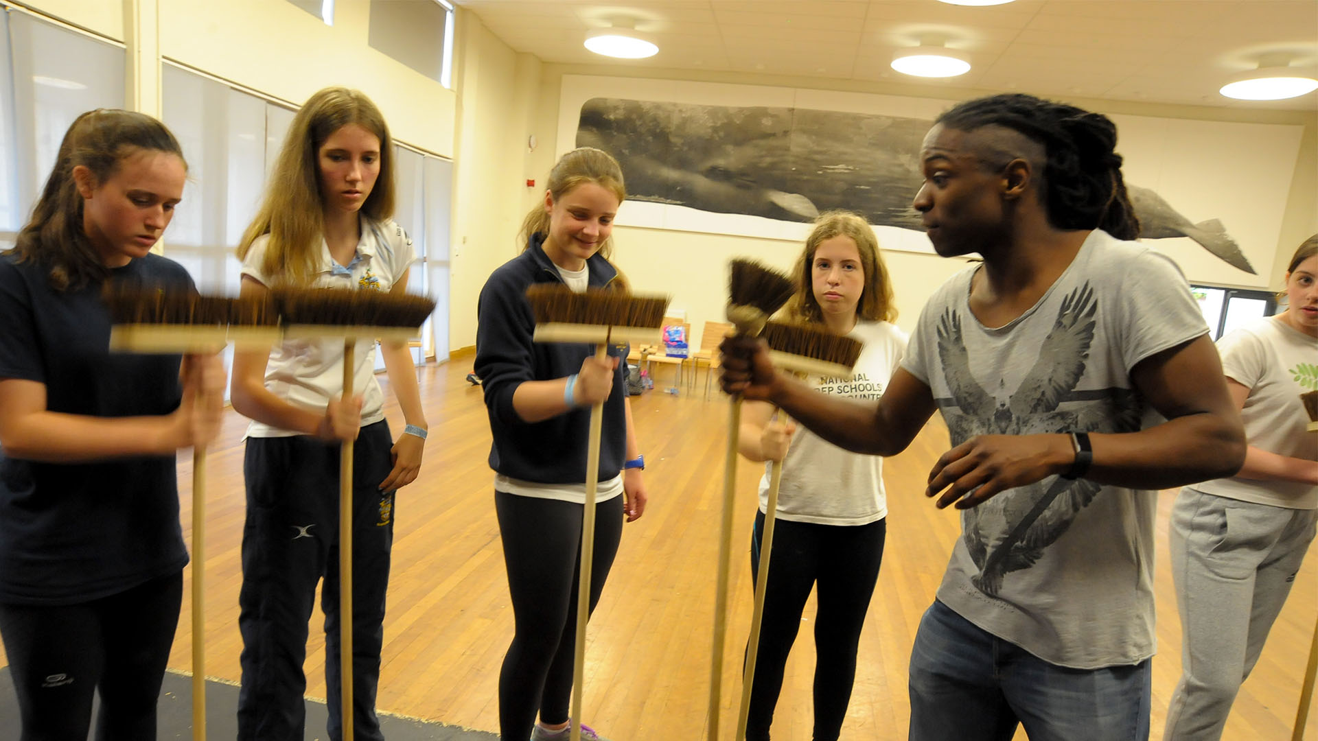 STOMP Workshop at Rugby School - Students learning how to play brooms with Nigel Clarke
